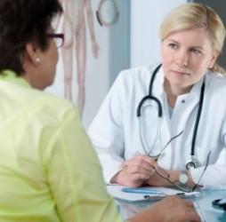 Doctor listening to patient