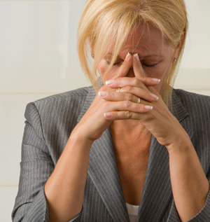 Woman Executive Pondering Her Problem Solutions